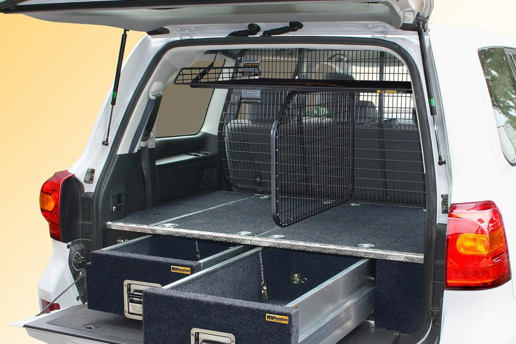 A 200 Series LandCruiser fitted with an RV Top Shelf/Dividing Barrier combo on our air bag compliant Half Cargo Barrier.