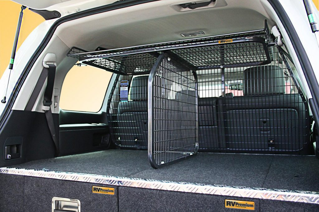 A 150 Prado fitted with an RV Top Shelf / Dividing Barrier combo on an airbag compliant Half Cargo Barrier.